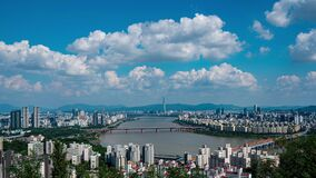 Landscape of Seoul City, modern building and han river with traffic on bridge seen from maebong mountian at summer in south korea