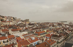 A cloudy day in Lisbon, Portugal. A view the city of Lisbon on a cloudy winter day. The image shows red-tiled roofs of the townhouses and the waters of the Royalty Free Stock Photography