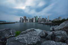 Cloudy day at Lower Manhattan Skyline view from Brooklyn Bridge. Park, New York United States Royalty Free Stock Photo