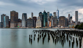 Cloudy day at Lower Manhattan Skyline view from Brooklyn Bridge. Park, New York United States Stock Photo