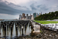 Cloudy day at Lower Manhattan Skyline view from Brooklyn Bridge Stock Photography