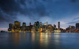 Cloudy day at Lower Manhattan Skyline view from Brooklyn Bridge Royalty Free Stock Images