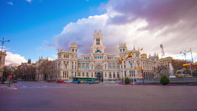 Cloudy day madrid city famous post office building 4k time lapse spain stock video footage