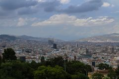 Cloudy day over Barcelona and Segrada Familia. Barcelona, Spain citycsape on an overcast day- dominated by Segrada Familia under construction Stock Photos
