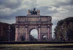 Cloudy day in Paris. The Arc de Triomphe du Carrousel in Paris Royalty Free Stock Image