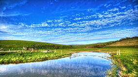 Cloudy day at seven sisters national park. Blue sky and green grass fields at seven sisters national park Royalty Free Stock Image