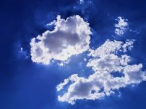 Cloudy day. Sun bursting out behind clouds Royalty Free Stock Photography