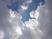 Cloudy day Sun rays Stock Photo