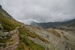 Cloudy day in Tatra Mountains on a trail from Zawrat to Five Polish Ponds Hostel Stock Images