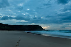 Cloudy Daybreak Seascape with Headland Silhouette. Taken at Birdie Beach, Munmorah on the Central Coast, NSW, Australia Stock Photo