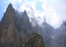 Cloudy Dolomite mountain peaks Stock Photography