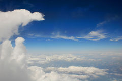 Cloudy Down Below. Fluffy Clouds Below from Outside of Plane Royalty Free Stock Photos