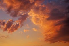 Cloudy dramatic sunset sky at dusk. Stock Photo