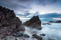 Cloudy Dusk at Whitsand Bay Stock Images