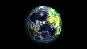 Cloudy Earth with green connections turning on itself with Earth image courtesy of Nasa.org Stock Photos