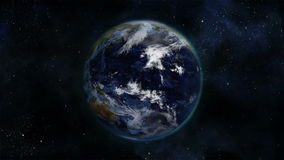 Cloudy Earth turning on itself with Earth image curtesy of Nasa.org stock video footage