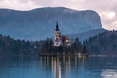 Cloudy Evening on Lake Bled. Purple Clouds Fill the Sky Above the Assumption of Mary on Lake Bled, Slovenia Stock Photography