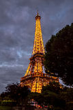 Cloudy evening under Eiffel tower Stock Image