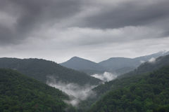 Cloudy and foggy summer nountain landscape Stock Photos