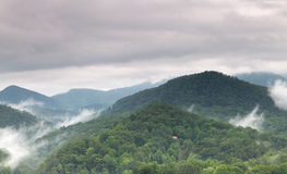 Cloudy and foggy summer nountain landscape Royalty Free Stock Images