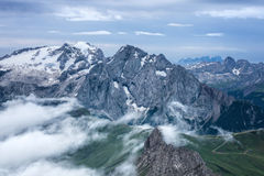 Cloudy and foggy sunrise at Dolomites mountains Stock Images