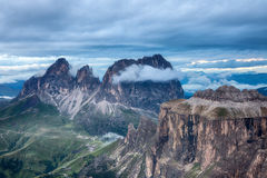 Cloudy and foggy sunrise at Dolomites mountains Royalty Free Stock Photo