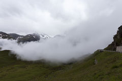 Cloudy and foggy weather in the mountains Stock Photos