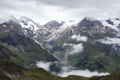 Cloudy and foggy weather in the mountains Royalty Free Stock Photo