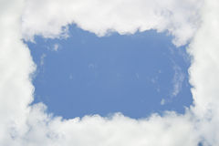 Cloudy frame, blue sky Stock Image