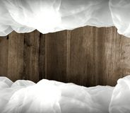 Cloudy frame with wooden background Stock Photo