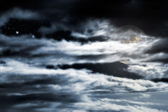 Cloudy full moon Stock Image