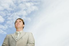 Cloudy future. Man looks forward with clouds in the background Stock Photos