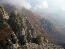 Cloudy Ghosts Vally. Demerdzhi Mountain Rocks. Cloudy Ghosts Vally. Demerdzhi Mountain Rocks And Bottom, Crimea, Ukraine. Luchistoe village in fog Stock Images