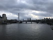 Cloudy and Gloomy London City over the River Thames with Landmarks. Landscape of London City / Town looking over the River Thames with landmarks in the royalty free stock photo