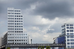 Bahnhof Potsdamer Platz. Cloudy gray sky above the Potsdamer Platz (in Berlin, Germany) subway and train station and surrounding buildings Royalty Free Stock Images