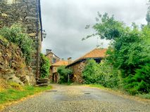 Cloudy grey sky in a French Ardeche village Stock Photos