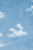 Cloudy grunge background. Abstract background of white clouds in blue sky with grunge or vintage effect stock photo