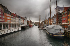 A cloudy harbor of København, Denmark. The city harbor in Copenhagen. With many sailing boat inside Royalty Free Stock Photo