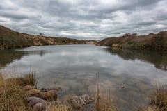 Cloudy Hengistbury head lake Stock Photo