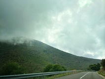 Cloudy highway in the mountains of Catalonia Royalty Free Stock Image