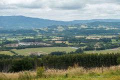 Cloudy hill landscape. 70 mm zoom landscape in a cloudy midday with some hills at background Stock Images