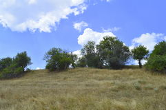 Cloudy hill in a summer day. View of a cloudy hill in a summer day stock image