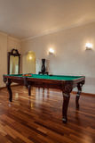 Cloudy home - billiard in living room. Cloudy home - billiard table standing in living room Royalty Free Stock Image