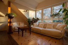 Cloudy home - bright couch. Cloudy home - bright and huge couch on the attic Royalty Free Stock Images