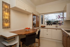 Cloudy home - bright interior. Of practical kitchen stock image