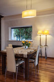 Cloudy home - classic dining room. Cloudy home - wooden table in classic dining room Stock Images