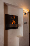 Cloudy home - modern fireplace. Cloudy home - closeup of original and modern fireplace Royalty Free Stock Images