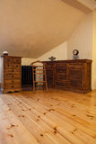 Cloudy home - vintage furniture. Cloudy home - old fashioned furniture in wooden room Royalty Free Stock Photography