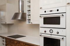 Cloudy home - oven. Cloudy home - closeup of white kitchen appliances Royalty Free Stock Image