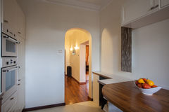 Cloudy home - View from the kitchen. Cloudy home - View at hallway from the kitchen interior Stock Photography